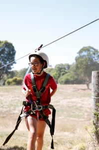Boy in flying fox harness