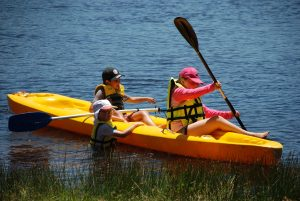 two children kayaking
